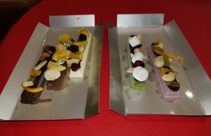 "My custom Kit Kat order: dark chocolate, milk chocolate, white chocolate, matcha, and ""ruby"" bars, from left to right, all covered with freeze-dried toppings."