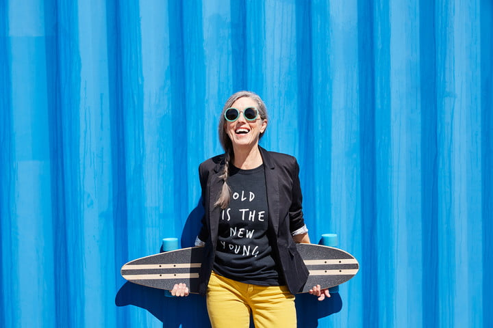 2019 photography trends hip and stylish senior woman with skateboard