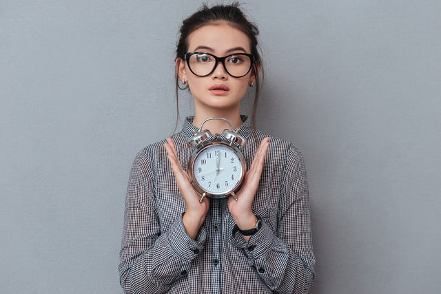 2019 photography trends young asian woman holding clock