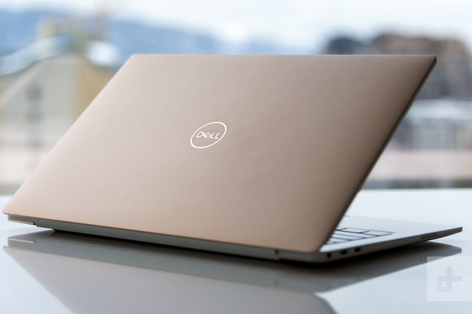 Dell XPS 13 9370 review | Laptop partially closed facing away from the camera at an angle showing lid and trim