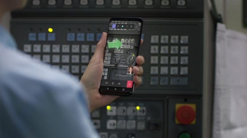 Remote Assist, with its green augmented reality arrow pointing out something of interest, on an Android phone.