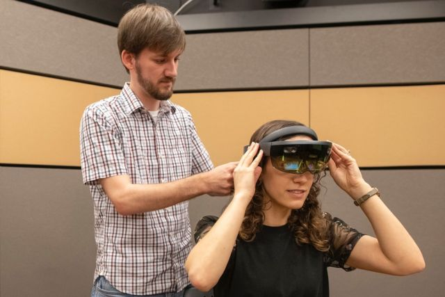 Co-author Mark Miller works with lab manager Talia Weiss to run through the experiment during a testing phase.