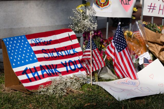 A memorial honoring Officer Brian Sicknick, who was beaten to death by rioters who stormed the US Capitol.