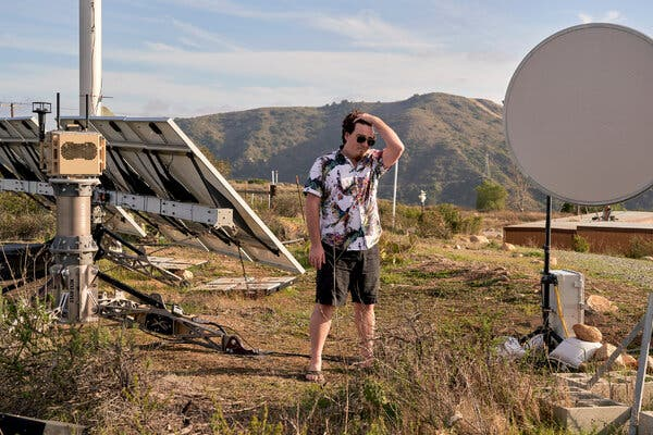 Palmer Luckey, a founder of Anduril, among the equipment at his company's testing range near Camp Pendleton in Southern California.